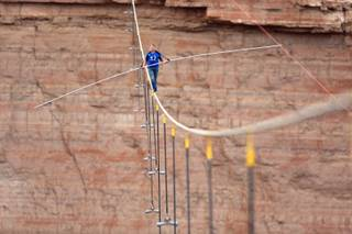 Nik Wallenda walks across a 2-inch wire 1500 feet above the ground to cross the Grand Canyon for Skywire Live With Nik Wallenda on the Discovery Channel, Sunday, June 23, 2013 at the Grand Canyon, Calif.