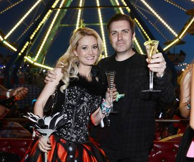 Holly Madison and Pasquale Rotella pose for photos in front of the Ferris wheel where he asked for her hand in marriage during the 17th annual Electric Daisy Carnival at Las Vegas Motor Speedway on Sunday, June 23, 2013.
