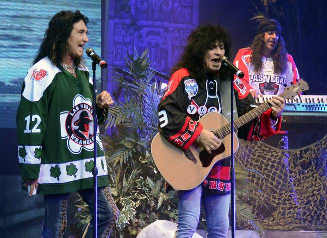 "The band in ""Raiding the Rock Vault"" at LVH wears Las Vegas Wranglers jerseys during ""Hotel California"" on Sunday, June 23, 2013."