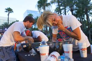 "Las Vegas competitive eater Miki Sudo, right, competes during a Hooters wing-eating contest at the Hard Rock Wednesday, June 26, 2013. Sudo won the competition, eating 192 wings in 10 minutes. Adrian ""the Rabbit"" Morgan, left, finished in second place."