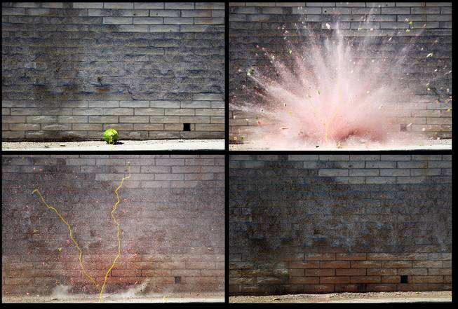 A watermelon is blown up with a blasting cap during the Las Vegas Fire Department's annual July 4th fireworks safety demonstration Wednesday, June 26, 2013