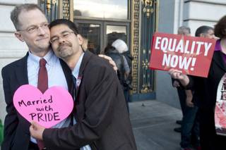 John Lewis, left, and Stuart Gaffney embrace outside San Francisco's City Hall shortly before the U.S. Supreme Court ruling cleared the way for same-sex marriage in California on Wednesday, June 26, 2013.
