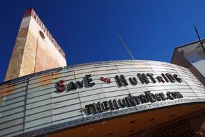 The Huntridge Theater marquee advertises a website seeking support in its preservation Thursday, June 27, 2013.