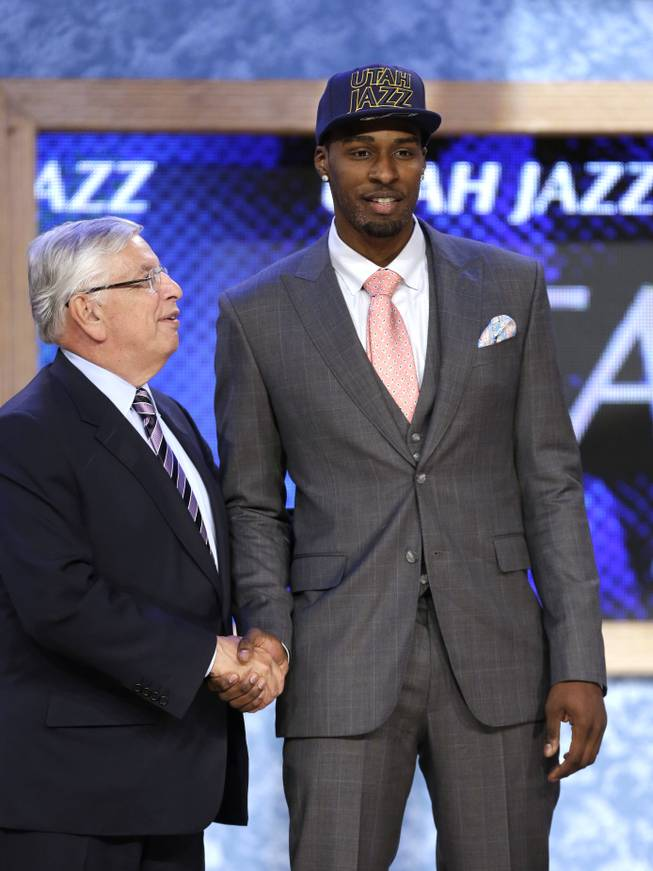 NBA Commissioner David Stern, left, shakes hands with UCLA's Shabazz Muhammad, who was selected by the Utah Jazz in the first round of the NBA basketball draft, Thursday, June 27, 2013, in New York.