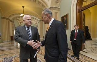 Sen. John McCain, R-Ariz., left, and Sen. Charles Schumer, D-N.Y., right, two of the authors of the immigration reform bill crafted by the Senate's bipartisan