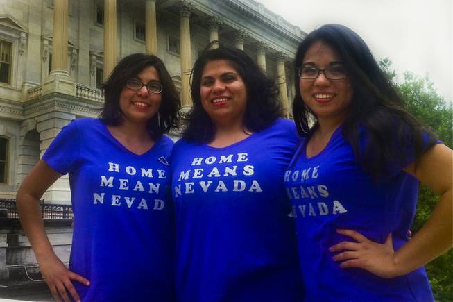 "From left to right: Las Vegans Blanca Gamez, 23 and Astrid Silva, 25, both immigrants without legal permission, and Sandra Gamez, 21, a U.S. citizen, pause for a picture outside of the U.S. Senate in their ""Home Means Nevada"" shirts Thursday, June 27, just prior to the Senate's final vote to pass comprehensive immigration reform."