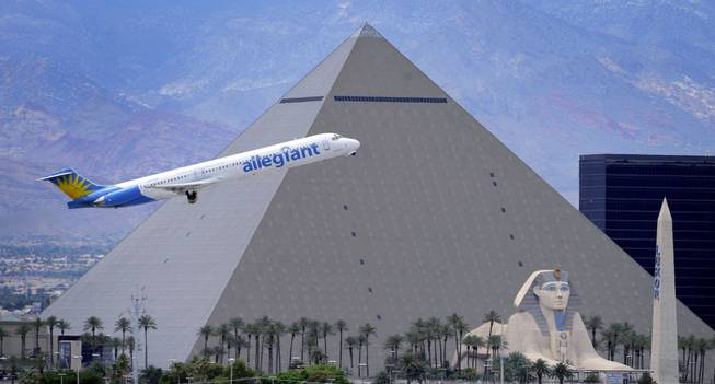 An Allegiant Air jetliner flies by the Luxor after taking off from McCarran International Airport, Thursday, May 9, 2013. While other U.S. airlines have struggled with the ups and downs of the economy and oil prices, Allegiant has been profitable for 12 straight years.