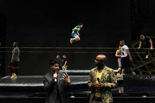 "As performers practice on slack lines, Director Jamie King, left, and Creative Director Welby Altidor speak to the media during a tour of the Michael Jackson ""One"" Theater at Mandalay Bay Saturday, June 29, 2013 before its world premier."