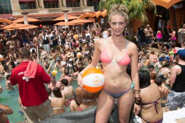 Sports Illustrated Swimsuit Issue model Julie Henderson celebrates her swimwear line for Basta Surf at Tao Beach in The Venetian on Saturday, June 29, 2013.