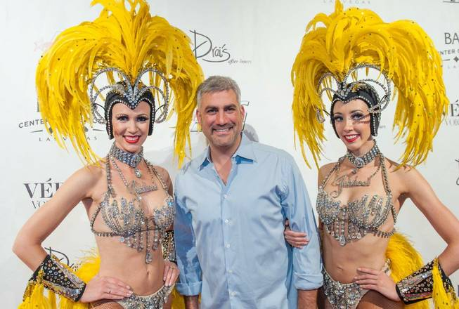 "Taylor Hicks and ""Jubilee!"" showgirls arrive at the ""Veronic Voices"" premiere at Bally's on Friday, June 28, 2013."