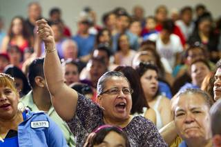 Maria Gudino,a Brady Linen Services employee, cheers during a rally for immigration reform at the Culinary Workers Union, Local 226, headquarters Monday, July 1, 2013.