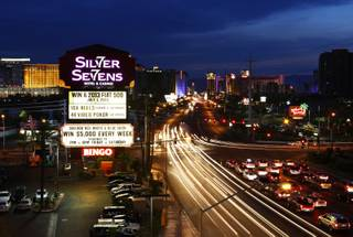 The neon sign at Silver Sevens Hotel & Casino is ceremonially lit in Las Vegas on Monday, July 1, 2013. Silver Sevens Hotel & Casino was formerly known as Terrible's Hotel and Casino.