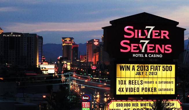 The sign at Silver Sevens Hotel & Casino is ceremonially lit in Las Vegas on Monday, July 1, 2013. Silver Sevens Hotel & Casino was formerly known as Terrible's Hotel and Casino.
