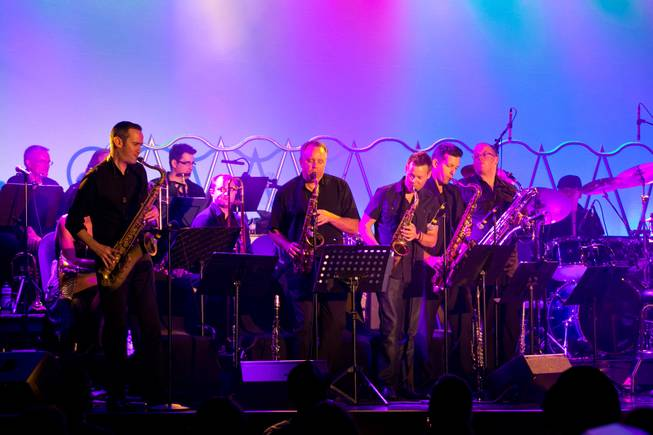 The Horn section of David Perrico's Pop Evolution, an 18-piece band featuring musicians from various Las Vegas productions, performs inside the showroom at the Stratosphere, July 2, 2013.