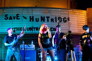 Arising Tide rocks the stage while performing at the Save the Huntridge concert fundraiser in the parking lot of the Huntridge Theatre in Las Vegas Saturday, June 29, 2013.