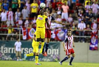 Narciso Mina, left, (7) of Club America and Kristian Alvarez, left, (3) of Chivas Guadalajara jump to head a ball during El Super Clasico soccer game at Sam Boyd Stadium Wednesday July 3, 2013.