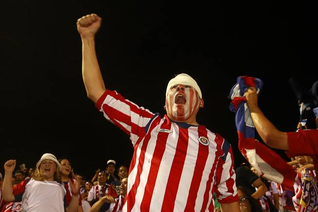 Mark Garcia of Los Angeles cheers for Chivas Guadalajara during El Super Clasico soccer game at Sam Boyd Stadium Wednesday July 3, 2013.