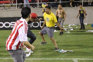 Fights break out on the field after El Super Clasico soccer game between Chivas and Club America Wednesday, July 3, 2013 at Sam Boyd Stadium.