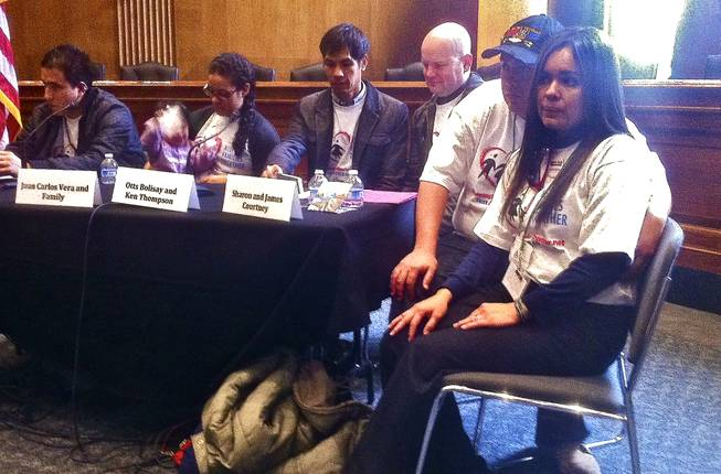 Sharon Courtney, right, sits next to her husband James listening to other undocumented immigrants share their personal stories. The Las Vegas couple came to Capitol Hill for an immigration rally at the Dirksen Senate Office Building to testify about their experience living with the threat of deportation looming over Sharon, March 13, 2013.