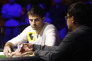Matt Ashton stares at Don Nguyen while waiting for his move during the final table of the Poker Players Championship Thursday, July 4, 2013 at the Rio.