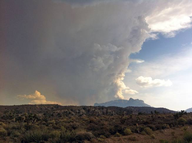 Smoke billows from a fire on Mount Charleston west of Las Vegas, Thursday, July 4, 2013.