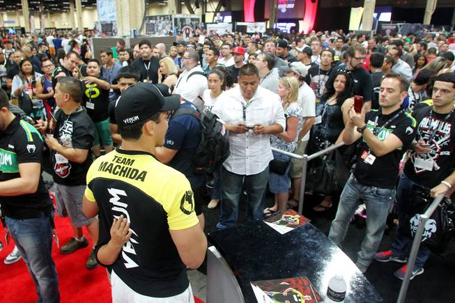 A long line of fans wait to meet Lyoto Machida during the UFC Fan Fest at Mandalay Bay Friday, July 5, 2013.