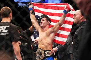 Chris Weidman celebrates his victory over Anderson Silva after their middleweight title fight at UFC 162 Saturday, July 6, 2013 at the MGM Grand Garden Arena. Weidman upset Silva with a second round knockout, taking the belt Silva has held since 2006.