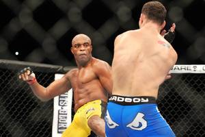 Anderson Silva throws a kick at Chris Weidman during their middleweight title fight at UFC 162 Saturday, July 6, 2013 at the MGM Grand Garden Arena. Weidman upset Silva with a second round knockout, taking the belt Silva has held since 2006.