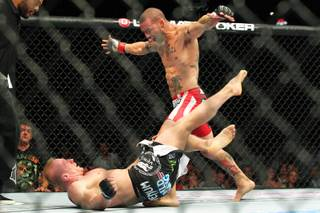 Cub Swanson taunts Dennis Siver into getting up before knocking him out during their fight at UFC 162 Saturday, July 6, 2013 at the MGM Grand Garden Arena.