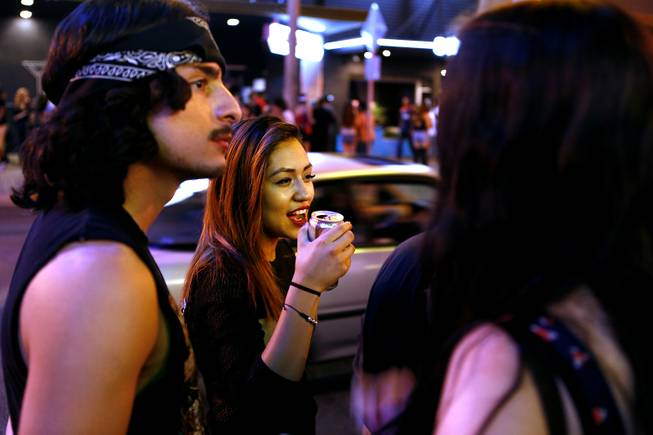 Liliana Villegas, 19, drinks beer with her friends on Fremont St. Friday, July 5, 2013.
