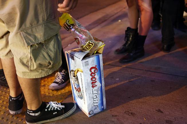 People with a case of beer hang out in the Fremont East District on Friday, July 5, 2013.