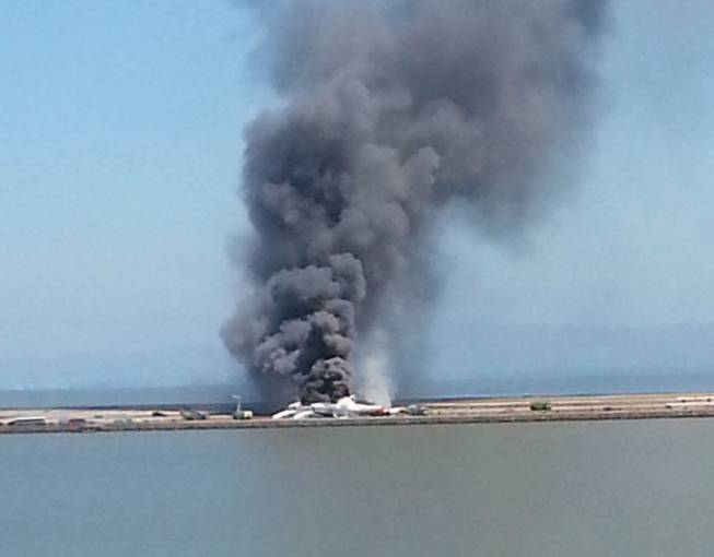This photo provided by Antonette Edwards shows what a federal aviation official says was an Asiana Airlines flight crashing while landing at the San Francisco airport Saturday, July 6, 2013.