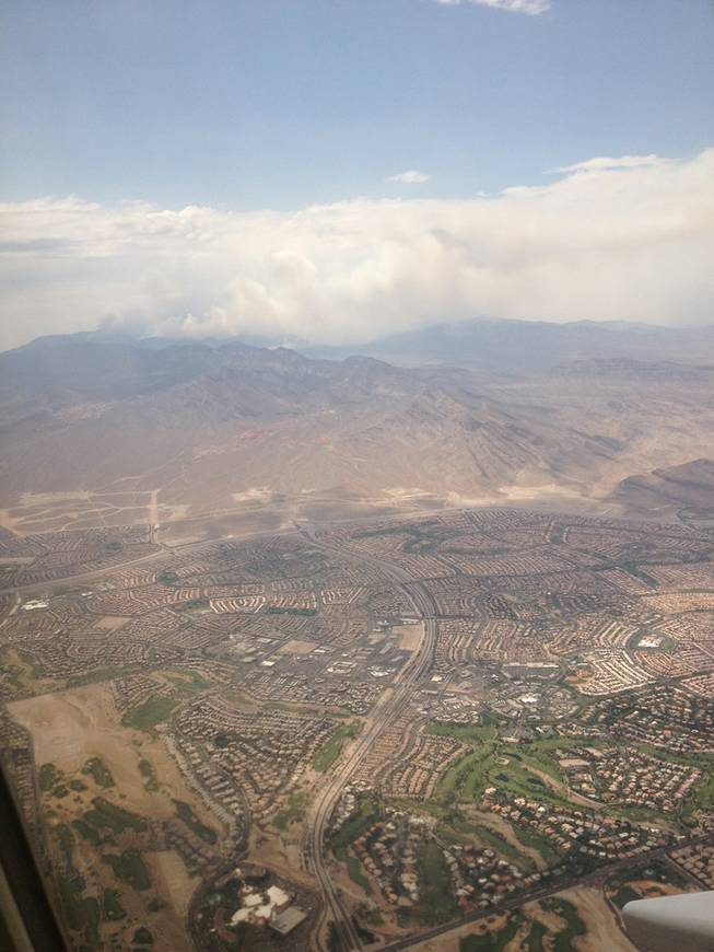 Smoke from Mount Charleston wildfire was visible to passengers taking off from McCarran International Airport Saturday, July 6.