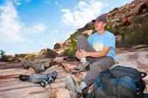 Simon Peck relaxes on the rocks prior to gearing up for a climb on the boulders at Calico Basin west of Red Rock Canyon Conservation ...