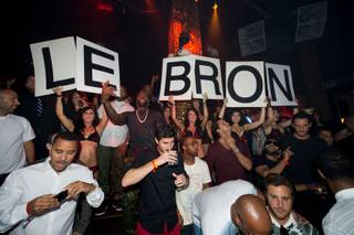LeBron James celebrates the Miami Heat's repeat NBA championship at Tao in The Venetian on Saturday, July 6, 2013.