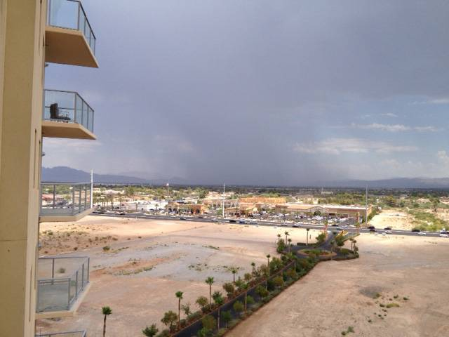 A thunderstorm moves north through the Las Vegas Valley about 12:45 p.m. Sunday. Rain in the area prompted the National Weather Service to issue a flash flood warning.