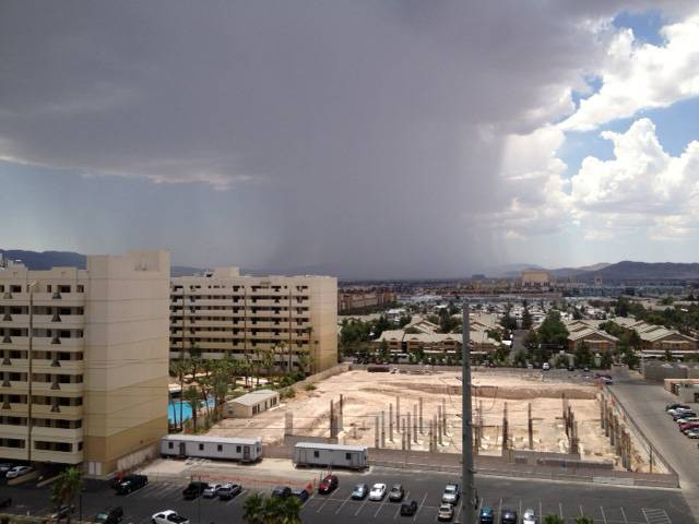 A thunderstorm moves through the southern Las Vegas Valley at noon Sunday, photographed from near Las Vegas Boulevard and Blue Diamond Road looking south. Spotty storms broke out early in the day, and a flash flood warning was in effect until 2:30 p.m.