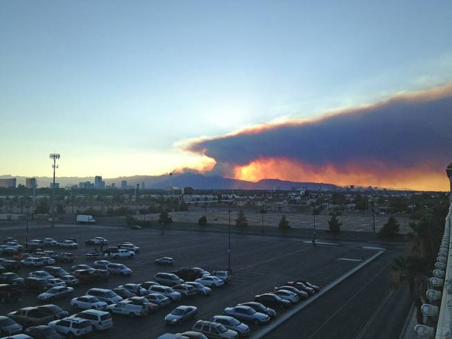 A view from Boulder Station of the sunset and smoke from the Mount Charleston wildfire, Monday, July 8, 2013.