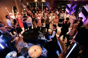 Guests enjoy themselves during Frankie Moreno's performance at the Gatsby Gamble event, Tuesday, July 9, 2013.