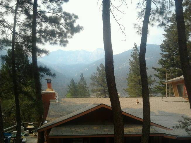 A view of Mount Charleston from behind the home of Rodney Giles, who chose not to evacuate his residence despite a nearby wildfire, Tuesday, July 9, 2013.