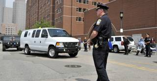 A U.S. Marshal's van, believed to be carrying Boston Marathon bombing suspect Dzhokhar Tsarnaev, arrives at the federal courthouse for his arraignment Wednesday, July 10, 2013, in Boston.