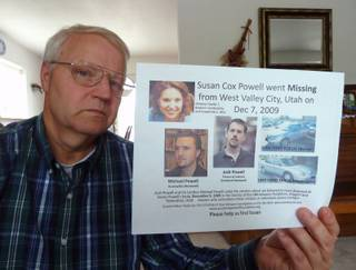 Chuck Cox holds a postesr seeking information in the 2009 disappearance of his daughter, Susan Powell. Police have suspended their case with the death of Powell's husband, who killed himself and their children, but Cox is still searching. He is shown at home in Puyallup, Washington, in July 2013. (John M. Glionna/Los Angeles Times/MCT)