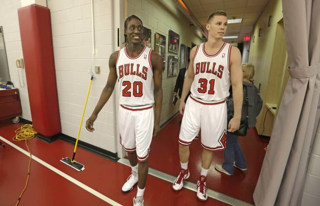 Chicago Bulls draft picks Tony Snell, left, and Erik Murphy enter the practice facility at the Berto Center Monday, July 1, 2013, in Deerfield, Ill., after changing into their new uniforms for the first time.