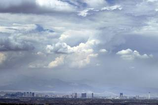 Storm clouds hang over Las Vegas on Friday, July 12, 2013. The National Weather Service has issued a flash flood warning that includes Southern Nevada and is in effect until 11 p.m.