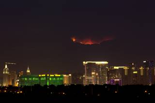A wildfire glows on Mount Charleston above Las Vegas, Wednesday, July 10, 2013.
