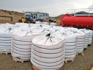 Large bags of fertilizer and red dye are stored near the tanker truck that will mix the powdered substance with water to form a liquid retardant at a mobile production facility near Mount Charleston. The retardant will be used to assist firefighters attacking the wildfire burning farther up the mountain.