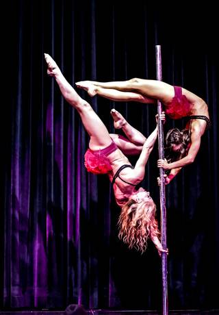 Duo pole act Sarafein and Charisma during the Sapphire Comedy Hour at Sapphire Gentlemen's Club, Friday, July 12, 2013.