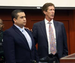 George Zimmerman, left, stands with defense counsel Mark O'Mara during closing arguments in his trial at the Seminole County Criminal Justice Center, in Sanford, Fla., July 12, 2013.