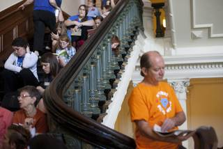Hundreds wait in line to enter the Senate gallery at the Texas State Capitol in Austin, Texas, Friday, July 12, 2013. The Texas Senate leader, Lt. Gov. David Dewhurst, has scheduled a vote for Friday on the same restrictions on when, where and how women may obtain abortions in Texas that failed to become law after a Democratic filibuster and raucous protesters were able to run out the clock on an earlier special session.