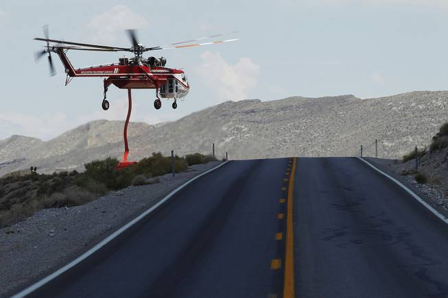 A Sikorsky Skycrane picks up a load of fire retardant near Kyle Canyon Road while fighting the Mt. Charleston fire Saturday, July 13, 2013.